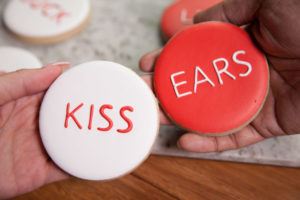 "cookies that say ""kiss"" and ""ears"""